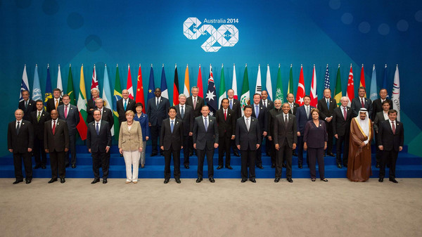 Participants pose for the G20 Leaders' Summit family photo in Brisbane in this November 15, 2014 handout photo by G20 Australia. Leaders of the top 20 industrialized nations will gather in Brisbane till Sunday for their annual G20 summit. From L-R: (bottom row) Russia's President Vladimir Putin, South Africa's President Jacob Zuma, France's President Francois Hollande, Germany's Chancellor Angela Merkel, Japan's Prime Minister Shinzo Abe, Australia's Prime Minister Tony Abbott, China's President Xi Jinping, U.S. President Barack Obama, Brazil's President Dilma Rousseff, Saudi Crown Prince Salman bin Abdulaziz, Turkey's Prime Minister Ahmet Davutoglu; (centre row) Mexico's President Enrique Pena Nieto, Spain's President Mariano Rajoy, European Commission President Jean-Claude Juncker, South Korea's President Park Geun-hye, Canada's Prime Minister Stephen Harper, Indonesia's President Joko Widodo, Britain's Prime Minister David Cameron, India's Prime Minister Narendra Modi, Italy's Prime Minister Matteo Renzi, European Council President Herman Van Rompuy, Argentina's Economy Minister Axel Kicillof; (top row) FSB Chairman Mark Carney, ILO Director-General Guy Ryder, IMF Managing Director Christine Lagarde, OECD Secretary-General Angel Gurria, Senegal's President Macky Sall, Singapore's Prime Minister Lee Hsien Loong, New Zealand's Prime Minister John Key, Mauritania's President Mohamed Ould Abdel Aziz, Myanmar's President Thein Sein, World Bank Group President Jim Yong Kim, WTO Director-General Roberto Azevedo and UN Secretary General Ban Ki-moon. REUTERS/G20 Australia/Handout via Reuters (AUSTRALIA - Tags: POLITICS ANIMALS)  ATTENTION EDITORS - FOR EDITORIAL USE ONLY. NOT FOR SALE FOR MARKETING OR ADVERTISING CAMPAIGNS. THIS IMAGE HAS BEEN SUPPLIED BY A THIRD PARTY. IT IS DISTRIBUTED, EXACTLY AS RECEIVED BY REUTERS, AS A SERVICE TO CLIENTS. NO SALES. NO ARCHIVES